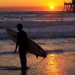A surfer at Sunset, Huntington Beach, California.